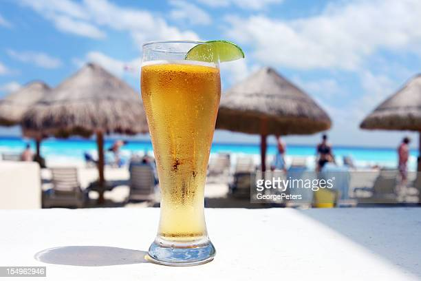 cold beer at the hot beach - mexican beer stock pictures, royalty-free photos & images