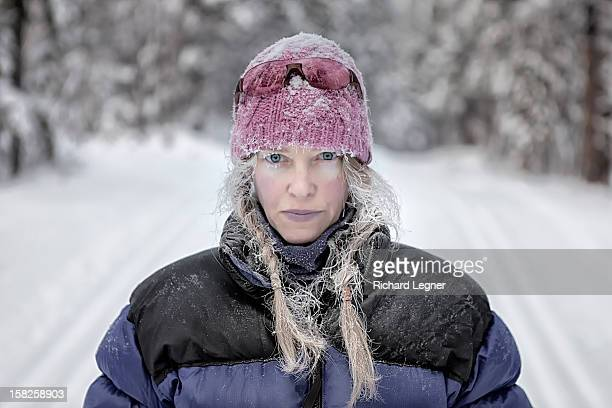 cold blond woman - winter coat stock pictures, royalty-free photos & images