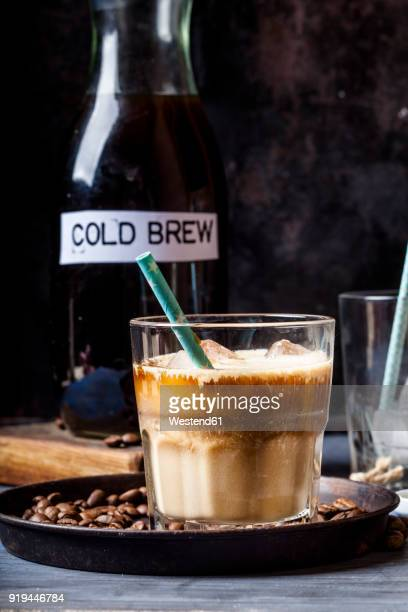 Cold brew coffee with ice cubes and coffee creamer