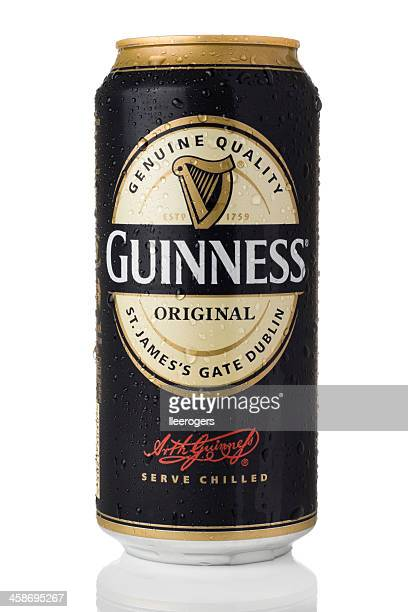 cold can of guinness original on a white background - guinness stock photos and pictures