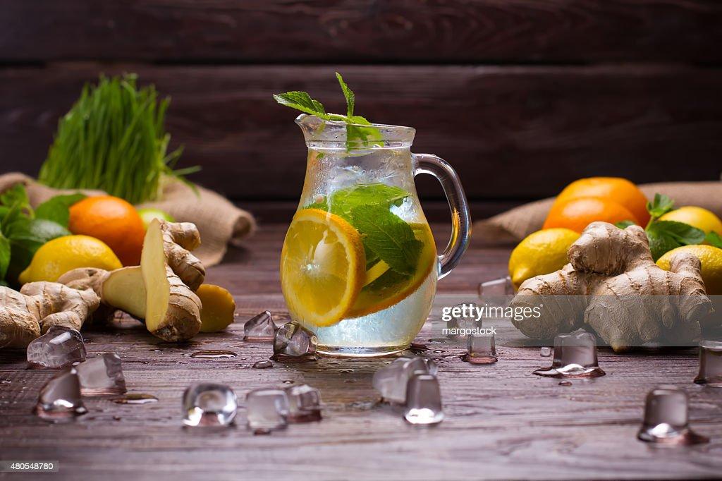 Cold citrusy lemonade in jug. : Stock Photo