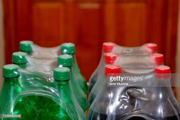 cold drink bottles packed and wrapped in plastic - soda bottle stock pictures, royalty-free photos & images