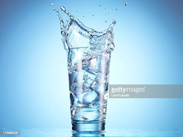 Cold drink water being poured into glass