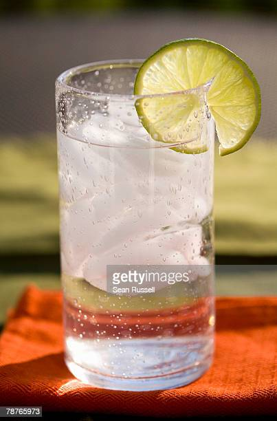 A cold drink with a slice of lime