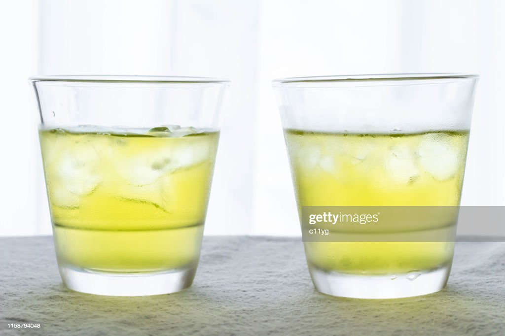 Cold green tea in a glass : Stock Photo