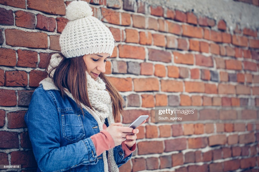 Cold Hands And Texting Stock Photo - Getty Images