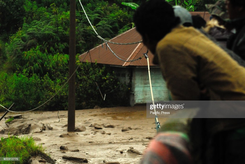 Cold lava floods as a result of the eruption of Mount Sinabung, hit the sigarang garang village in Karo district.