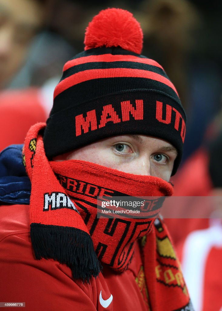 A Cold Man Utd Fan Wrapped Up In Scarves And A Bobble Hat