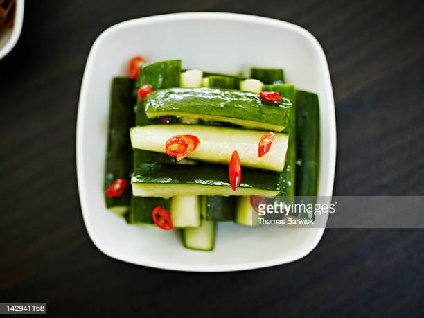 Cold mixed baby cucumber topped with diced chilies