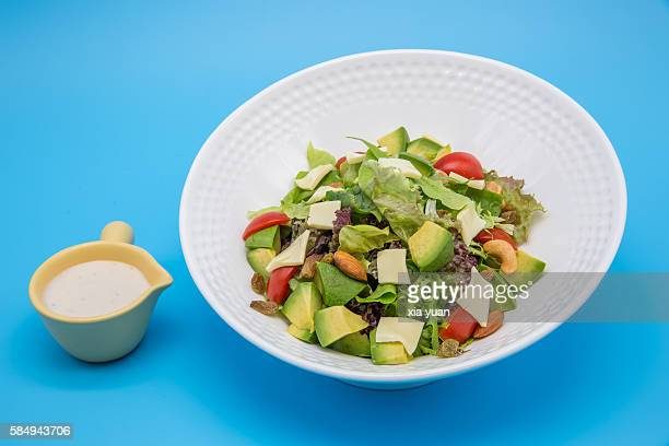 Cold mixed fresh vegetables salad with salad dressing