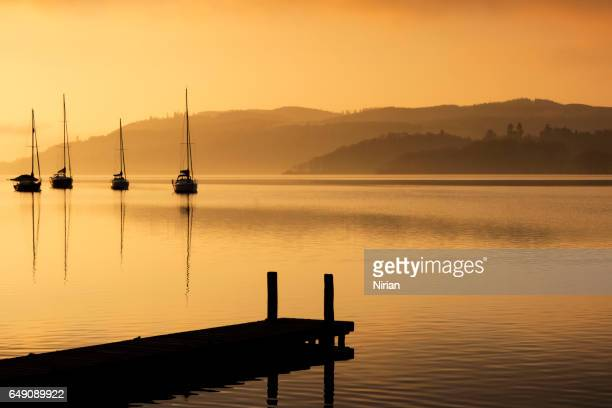 cold morning on the lake windermere - ambleside stock photos and pictures
