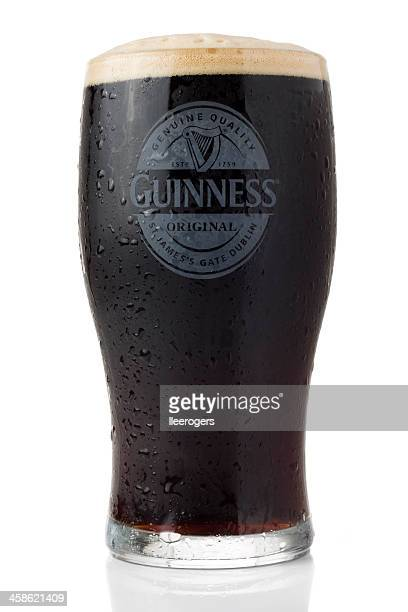 cold pint of guinness isolated on a white background - guinness stock photos and pictures