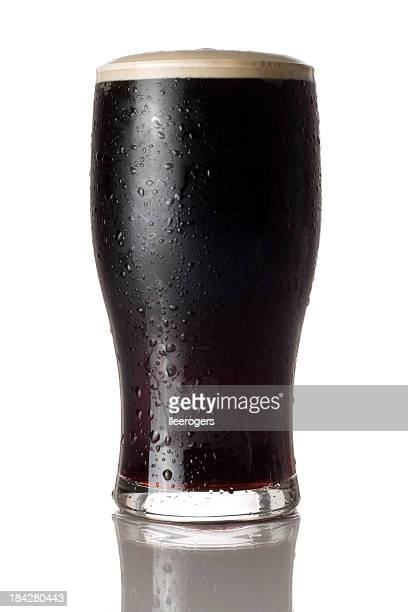 Cold pint of stout isolated on a white background