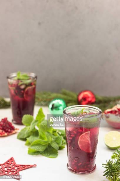 cold purple cocktail lemonade with fruit