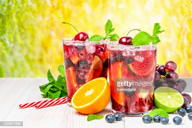 cold refreshing sangria with fruits on rustic wooden table - sangria stock pictures, royalty-free photos & images