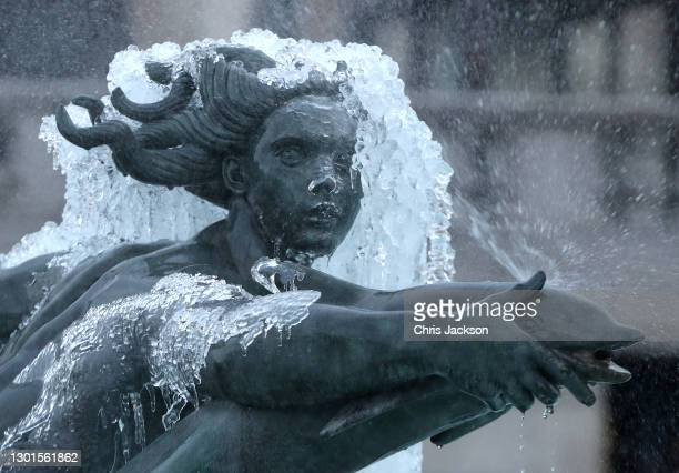 Cold temperatures have caused the fountains of Trafalgar Square to freeze on February 11, 2021 in London, England. Heavy snow brings a week of...