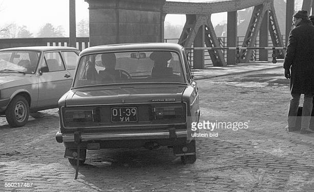 Spy swap at Glienicker Bruecke forthcoming a car of the Group of Soviet Forces in Germany on the way to Potsdam waiting photographers and journalists