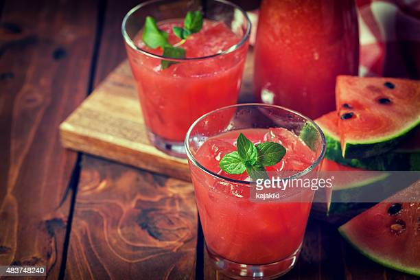 cold watermelon smoothie - watermelon stock pictures, royalty-free photos & images