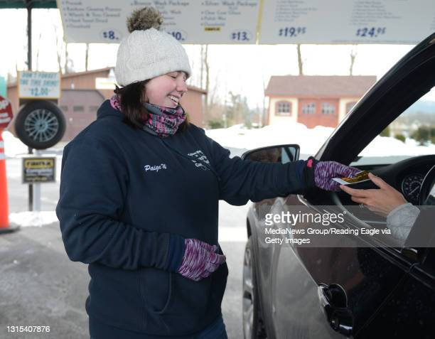 Cold Weather work Paige Weilacher, car wash attendant at Scott's Car Wash in Exeter, greets a customer and takes their payment prior to them going...