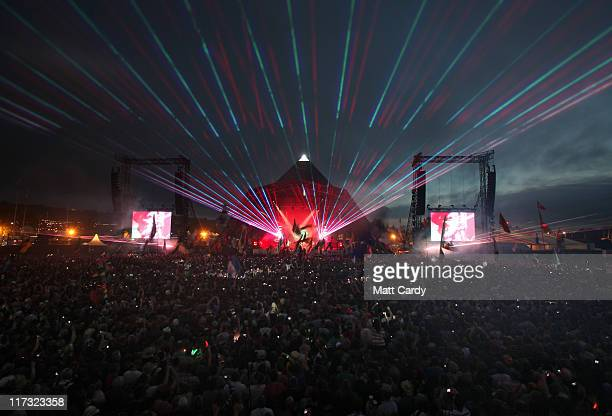Coldplay perform on the main Pyramid Stage at the Glastonbury Festival site at Worthy Farm Pilton on June 25 2011 This year's festival features...