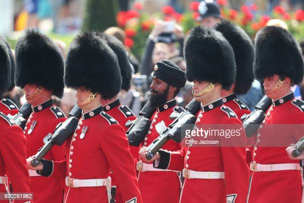 Coldstream Guards soldier Charanpreet Singh Lall the first to wear a turban during the ceremony marches during Trooping The Colour on the Mall on...