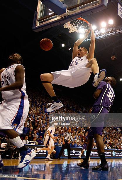 Cole Aldrich of the Kansas Jayhawks dunks against the Kansas State Wildcats during the game on January 13 2009 at Allen Fieldhouse in Lawrence Kansas