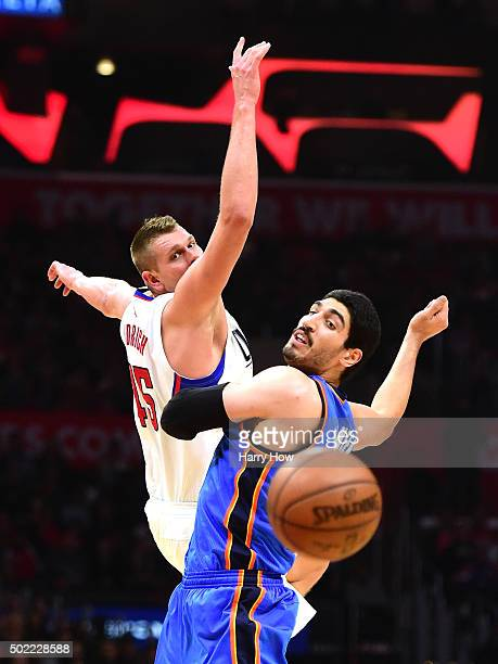 Cole Aldrich of the Los Angeles Clippers and Enes Kanter of the Oklahoma City Thunder collide for a loose ball during the first half at Staples...