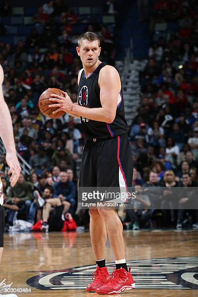 Cole Aldrich of the Los Angeles Clippers handles the ball against the New Orleans Pelicans on December 31 2015 at the Smoothie King Center in New...