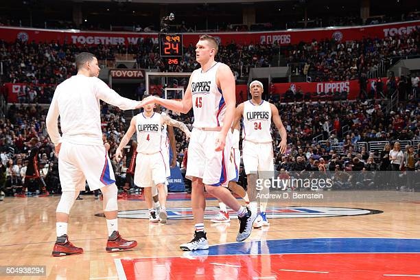 Cole Aldrich of the Los Angeles Clippers shakes hands with his teammates during the game against the Miami Heat on January 13 2016 at STAPLES Center...