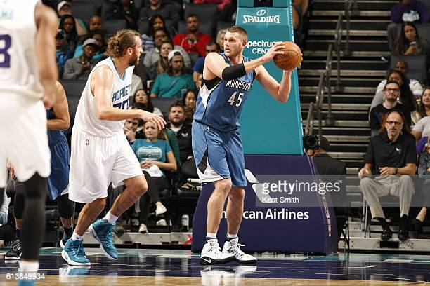 Cole Aldrich of the Minnesota Timberwolves handles the ball against the Charlotte Hornets during a preseason game on October 10 2016 at the Spectrum...