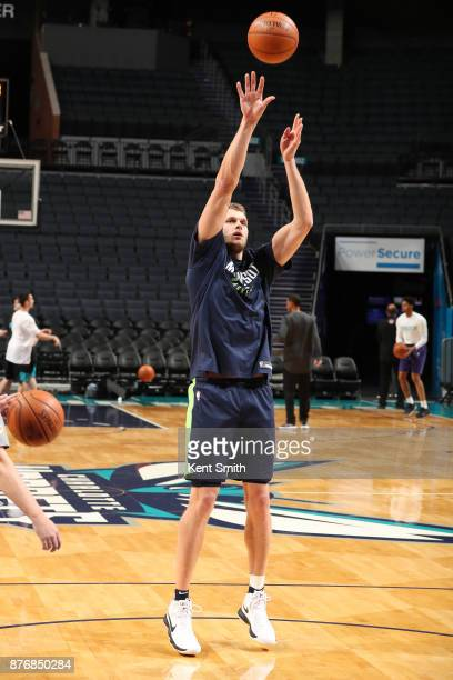 Cole Aldrich of the Minnesota Timberwolves shoots the ball during warmups before the game against the Charlotte Hornets on November 20 2017 at...