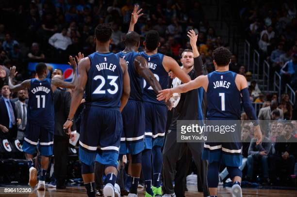 Cole Aldrich of the Minnesota Timberwolves with his teammates celebrate a win against the Denver Nuggets on December 20 2017 at the Pepsi Center in...