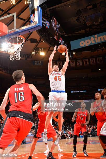 Cole Aldrich of the New York Knicks goes up for the ball against the Toronto Raptors during the game on April 16 2014 at Madison Square Garden in New...