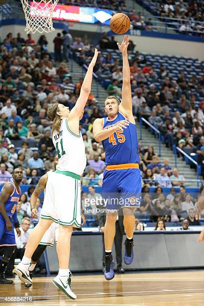 Cole Aldrich of the New York Knicks shoots against Kelly Olynyk of the Boston Celtics during a preseason game at the XL Center on October 8 2014 in...