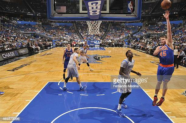 Cole Aldrich of the New York Knicks shoots against the Orlando Magic on April 11 2015 at Amway Center in Orlando Florida NOTE TO USER User expressly...