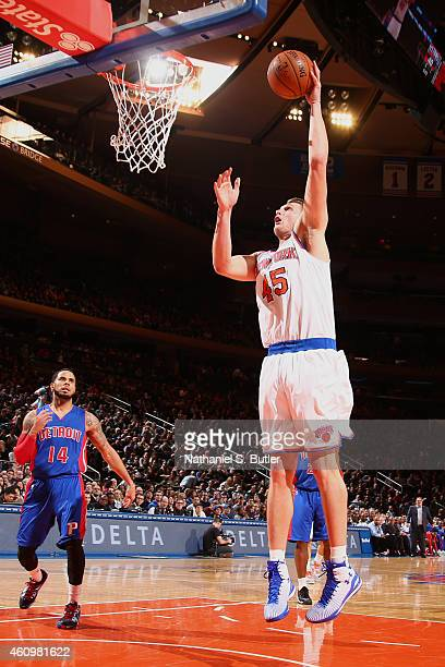 Cole Aldrich of the New York Knicks shoots the ball against the Detroit Pistons during the game on January 2 2015 at Madison Square Garden in New...