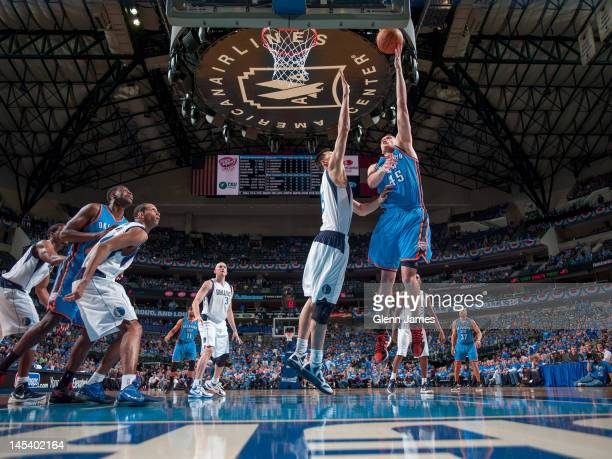 Cole Aldrich of the Oklahoma City Thunder goes to the basket over Yi Jianlian of the Dallas Mavericks in Game Three of the Western Conference...