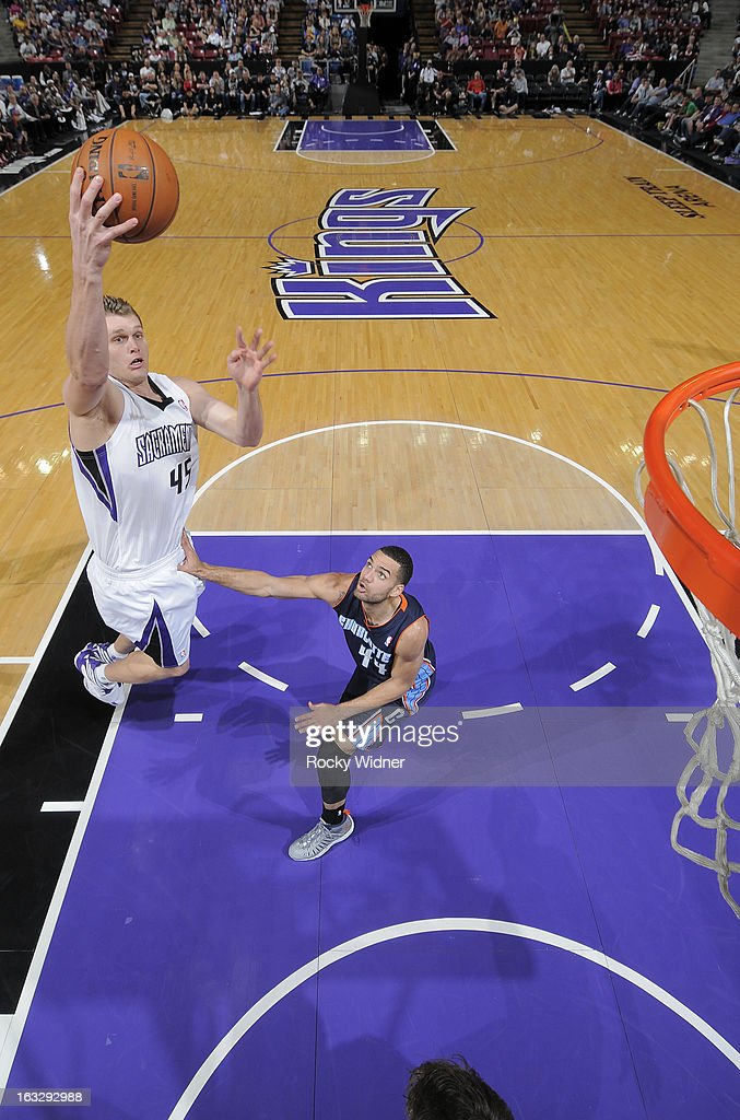 Cole Aldrich #45 of the Sacramento Kings shoots against Jeff Taylor #44 of the Charlotte Bobcats on March 3, 2013 at Sleep Train Arena in Sacramento, California.