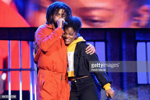 J Cole and Ari Lennox perform onstage during 2017 Budweiser Made in America Day 1 at Benjamin Franklin Parkway on September 2 2017 in Philadelphia...