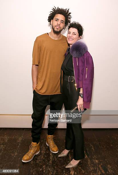 J Cole and Bally CEO of the Americas Claudia Cividino attend BALLY's 'Off the Grid' New York Premiere on August 5 2015 in New York City