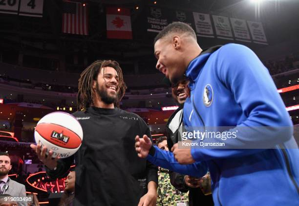 J Cole and Dennis Smith Jr attend the 2018 Verizon Slam Dunk Contest at Staples Center on February 17 2018 in Los Angeles California