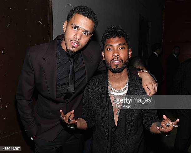 J Cole and Miguel attend the Beats Music Launch Party at Belasco Theatre on January 24 2014 in Los Angeles California