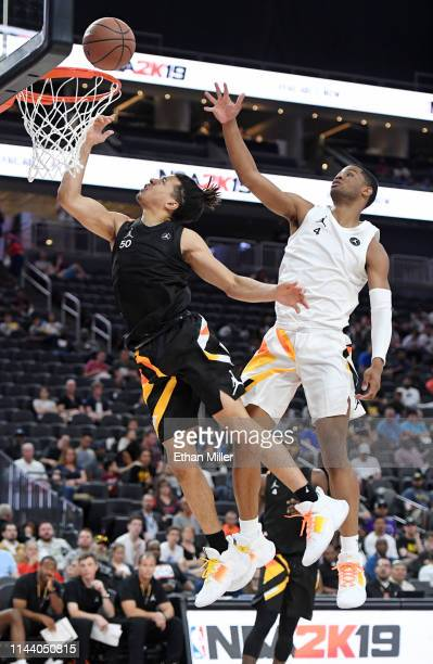 Cole Anthony is fouled as he drives to the basket against Cassius Stanley during the Jordan Brand Classic boys high school allstar basketball game at...