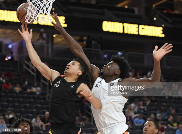 Cole Anthony is fouled as he drives to the basket against Isaiah Stewart during the Jordan Brand Classic boys high school allstar basketball game at...