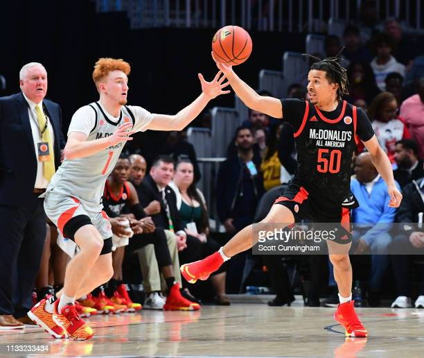 Cole Anthony of Oak Hill Academy in Virginia battles for a loose ball against Nico Mannion of Pinnacle High School in Arizona during the 2019...