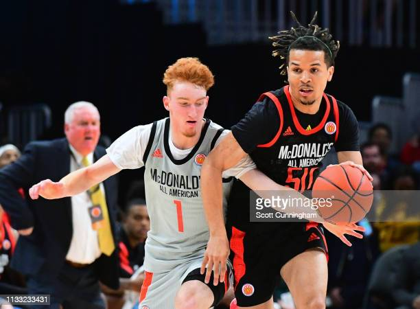 Cole Anthony of Oak Hill Academy in Virginia drives against Nico Mannion of Pinnacle High School in Arizona during the 2019 McDonald's High School...