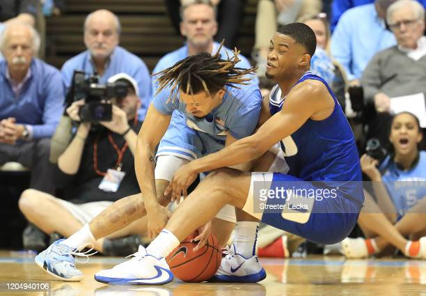 Cole Anthony of the North Carolina Tar Heels battles for a loose ball with Cassius Stanley of the Duke Blue Devils during their game at Dean Smith...