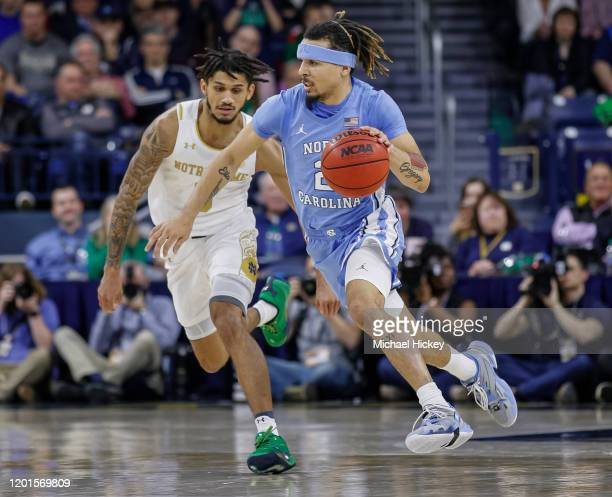 Cole Anthony of the North Carolina Tar Heels brings the ball up court against Prentiss Hubb of the Notre Dame Fighting Irish during the second half...