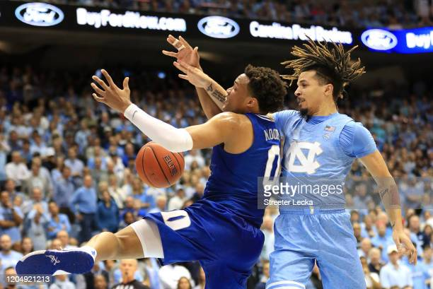 Cole Anthony of the North Carolina Tar Heels collides with Wendell Moore Jr #0 of the Duke Blue Devils during their game at Dean Smith Center on...