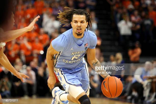 Cole Anthony of the North Carolina Tar Heels dribbles in the first half during a game against the Virginia Cavaliers at John Paul Jones Arena on...